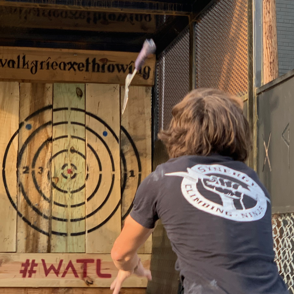 Throwing a large axe at a target